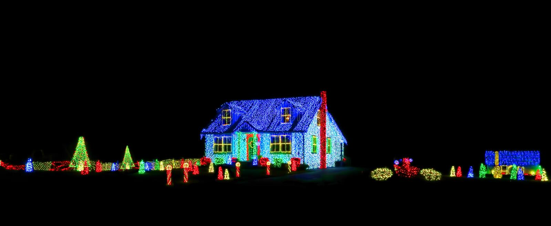 Christmas Lights Show Display on House and Yard stock image
