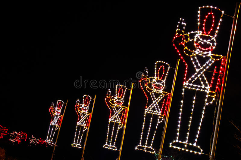 Christmas Lights - Toy Soldiers Saluting!. A colorful christmas holiday light display of toy soldiers saluting and other lights royalty free stock photos