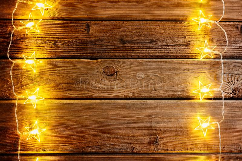 Christmas Lights On Wooden Rustic Background Frame Of With Space For Text Merry