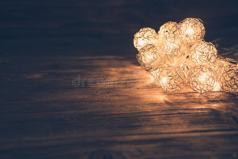 Christmas lights on wooden surface. Christmas or New Year concept stock photo