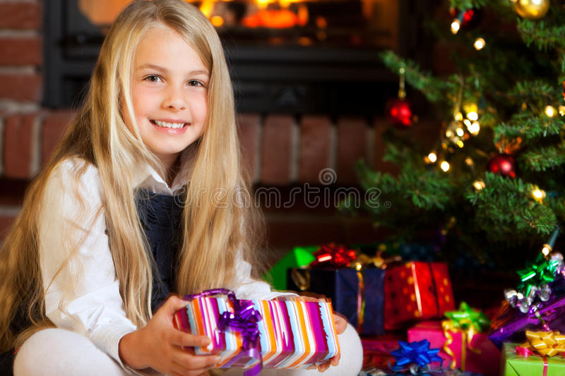 Download Christmas -  Little Girl Holding Gift And Smiling Stock Photo - Image: 21368048