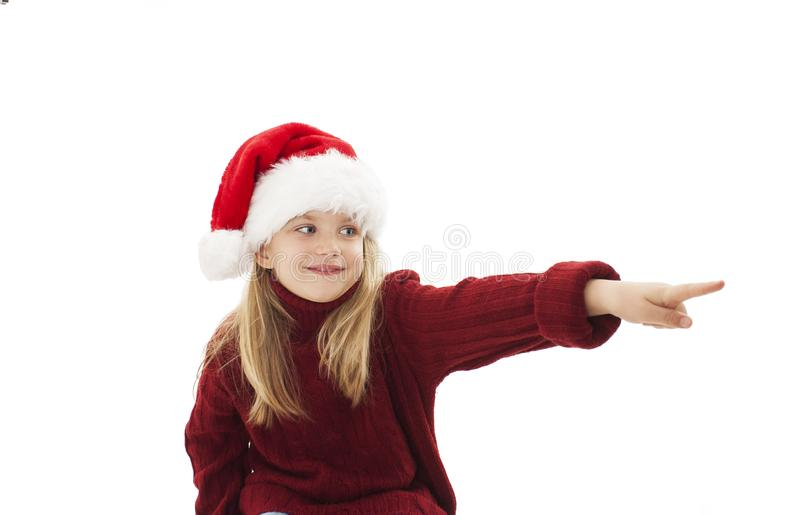 Christmas little girl pointing at copy space royalty free stock photo