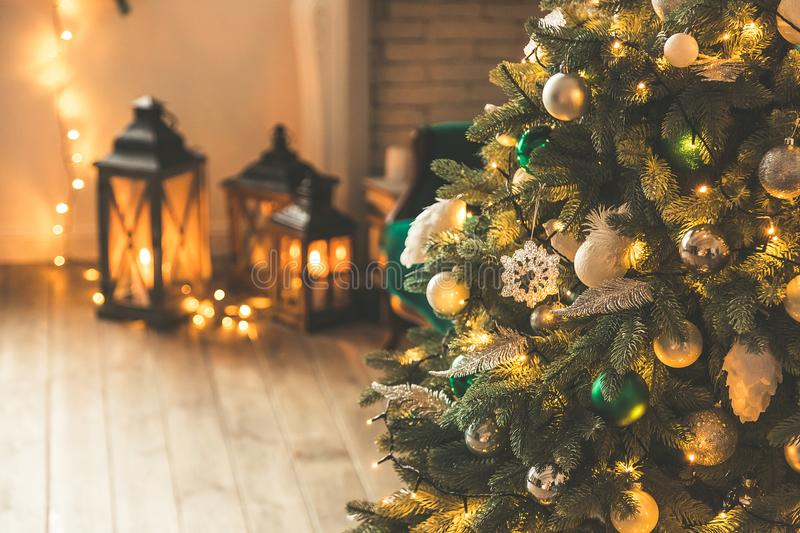 Christmas living room with a Christmas tree and gifts, candles, lanterns. Beautiful New Year decorated classic home interior. Wint stock photos