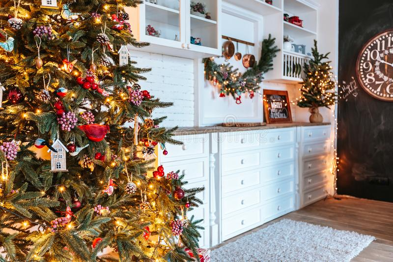 Christmas living room with a Christmas tree, gifts and clock. Beautiful New Year decorated classic home interior. Winter backgroun royalty free stock photos