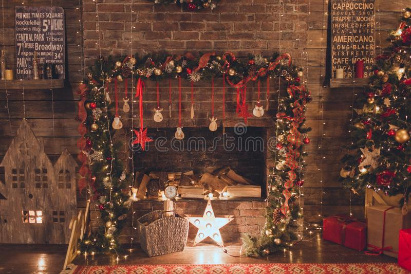 Christmas living room with fire place and garland lights royalty free stock photos