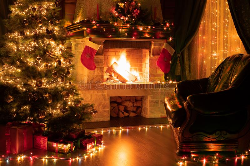 Christmas living room home interior. Christmas living room interior with decorated fireplace, armchair and xmas tree royalty free stock photography