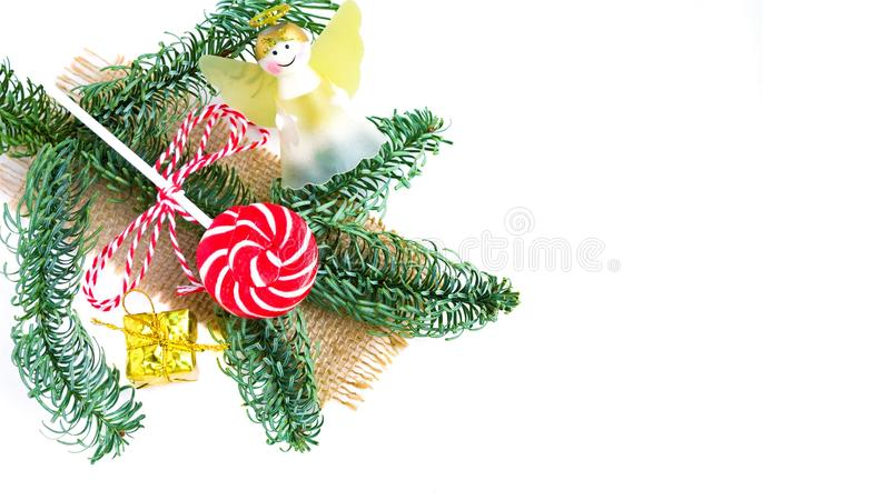 Christmas lollipop and сhristmas tree branch on white. Copy space. Flat lay. New Year and Christmas sweets royalty free stock photos