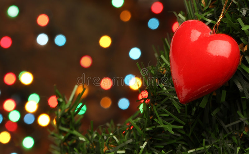 Christmas love heart. Hanging on a tree branch stock image