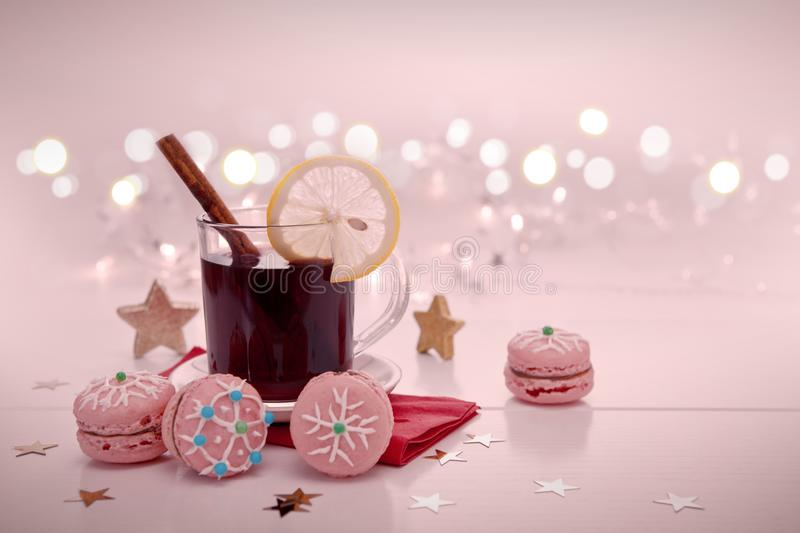Christmas macaroons and mulled wine on blur background. royalty free stock photos
