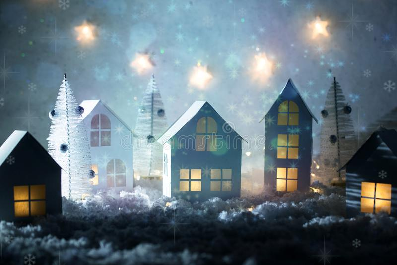 Christmas magic background with little decorative houses, beautiful festive still life, cute small houses at night, happy winter h stock photography