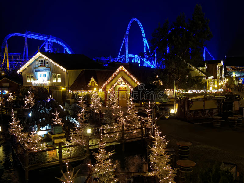 Christmas magic at Blue Fire roller coaster by night. Christmas magic in the Icelandic themed area in Europa Park Rust, Germany. The mega coaster Blue Fire in royalty free stock images