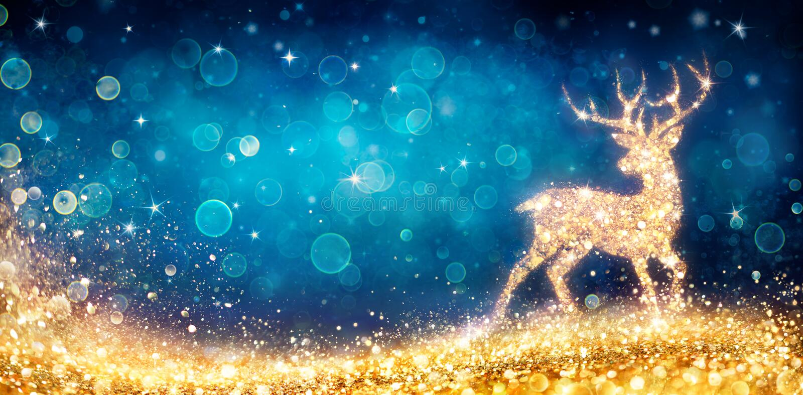Christmas - Magic Golden Deer In Shiny Blue. Background royalty free stock images