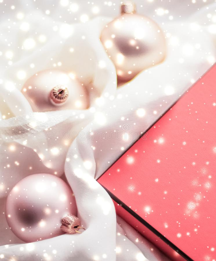 Christmas magic holiday background, festive baubles, coral vintage gift box and golden glitter as winter season present for luxury royalty free stock photos