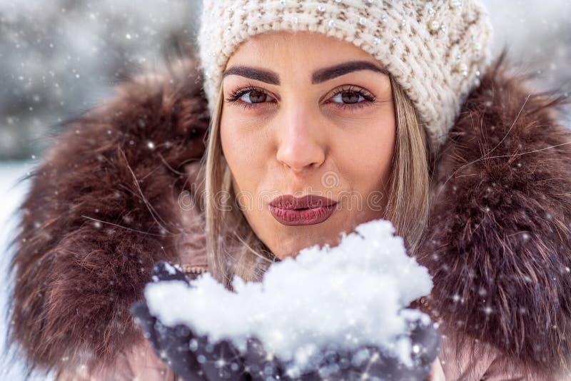 Christmas magic. Woman blowing magic snow. Christmas magic. Woman blowing beautiful magic snow stock photography