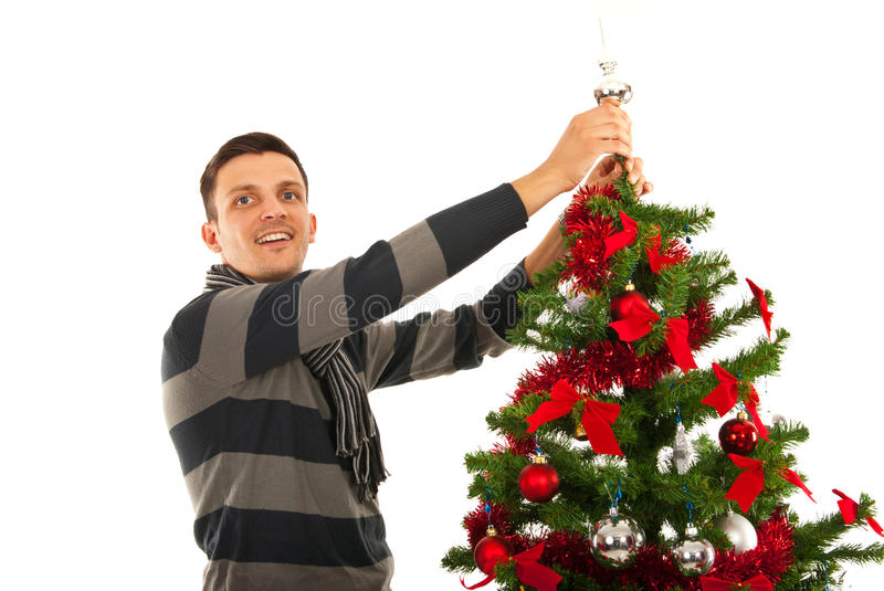 Christmas man decorate tree. Isolated on white background stock image