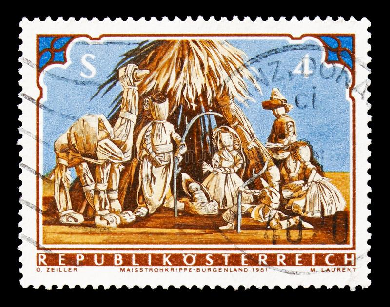 Christmas manger made of corn straw, Christmas serie, circa 1981. MOSCOW, RUSSIA - AUGUST 18, 2018: A stamp printed in Austria shows Christmas manger made of stock image