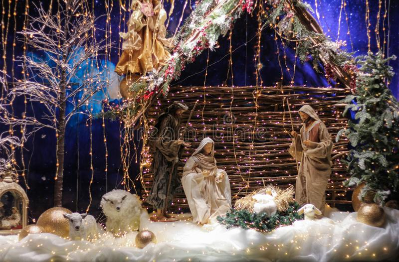 Christmas Manger scene with figures including Jesus, Mary, Joseph,. Sheep and magi royalty free stock image