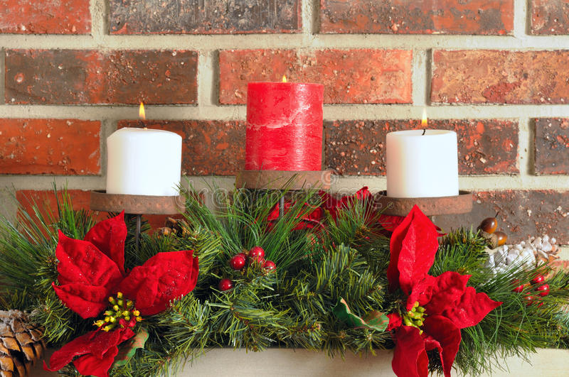 Christmas mantel decor. Festive Christmas decorations on a mantel with brick background royalty free stock photography