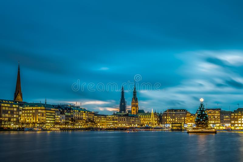 Christmas Market with Christmas Tree on Alster in Hamburg stock image