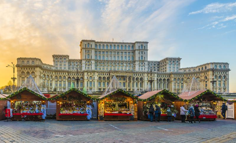 Christmas market and decorations in Bucharest center, Parliament building in background, Romania. Christmas market and decorations in center of Bucharest royalty free stock photos