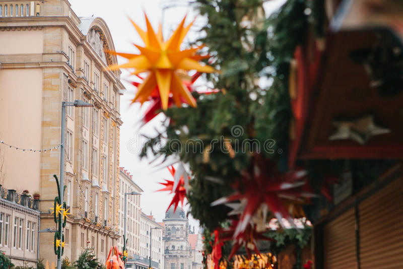 The famous Dresden Christmas market in Germany. Celebrating Christmas in Europe. Selective focus on the building. stock photos