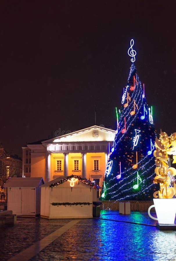 Christmas Market illumination at night. Vilnius Town Hall and a traditional european Christmas Market illumination at night stock image