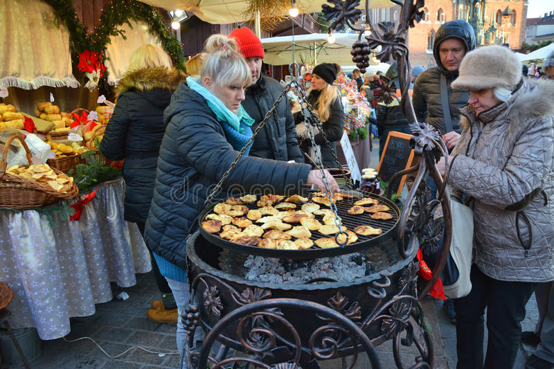 Christmas market in Krakow. KRAKOW, POLAND - DECEMBER 4, 2016: Christmas market stall with Grilled cheese oscypek.The annual Christmas markert in the Market royalty free stock photo