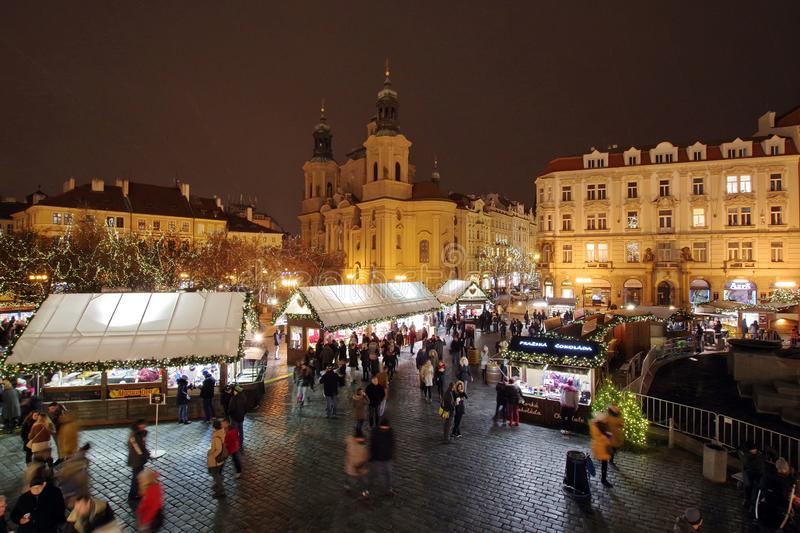 Christmas Market and lights of night in Prague, in 2016. Old Town Square with tourists. St. Nicholas Church royalty free stock images