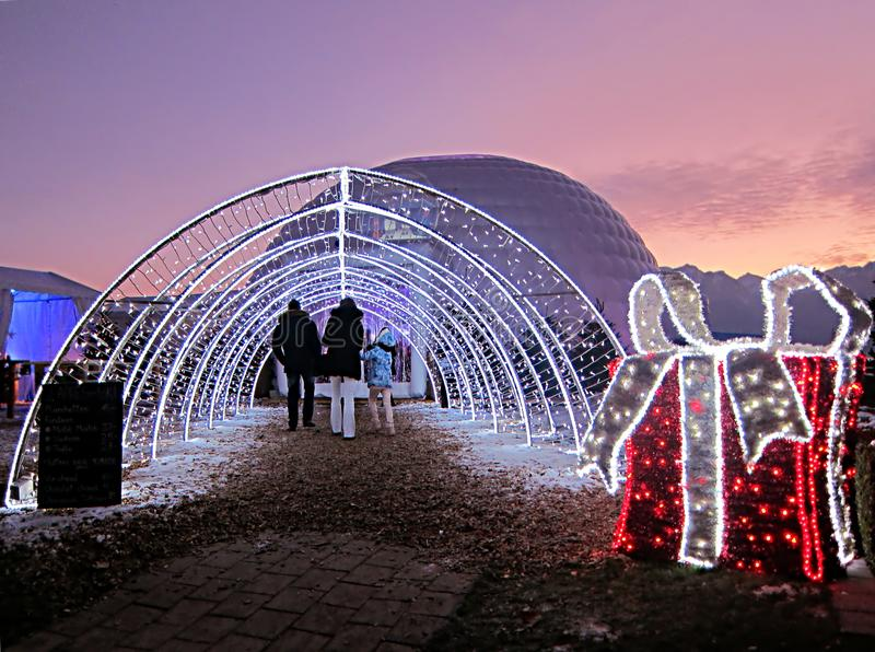 Christmas market in Montreux, Switzerland, at sunset with a beau. Tiful colored sky and Christmas decorations stock images