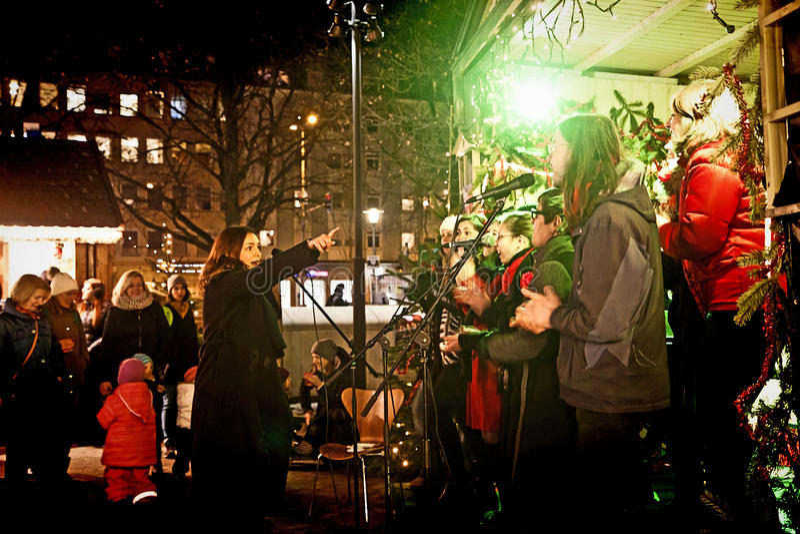 Christmas Market in Munich Harras at night, gospel choir royalty free stock image