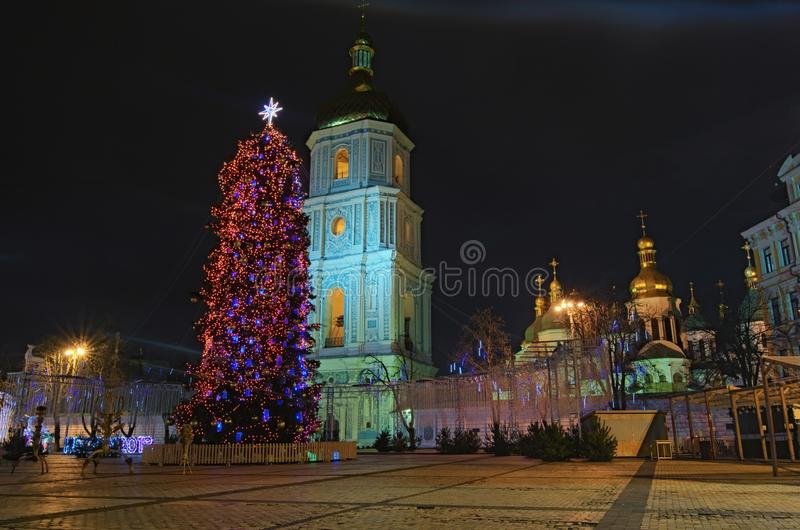 Christmas market without people in the early morning on Sophia Square in Kyiv, Ukraine. Main Kyiv`s New Year tree. And Saint Sophia Cathedral on the background stock images