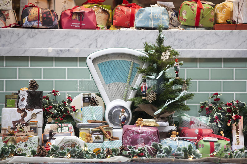 Christmas market stall with food and Christmas tree - Christmas shopping - Christmas season in Hamburg, Germany 16, 2016 in London royalty free stock photos