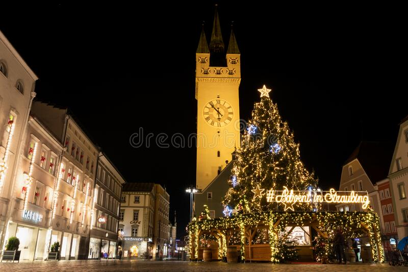 Christmas market in Straubing, Germany at night. With tower, Christmas tree stock photo