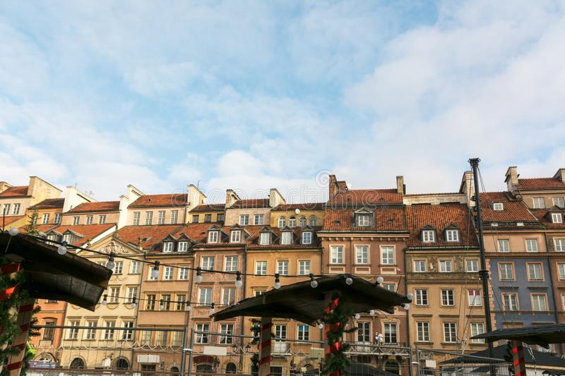 Christmas market in Warsaw Old Town Market Square. Detail of the old colorful facades stock photography