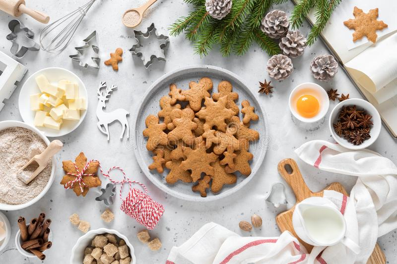 Christmas or X-mas baking culinary background, cooking recipe. Xmas, Noel gingerbread cookies on kitchen table and ingredients. For festive baking. New Year royalty free stock image