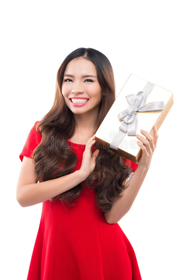 Christmas, x-mas, winter, happiness concept - smiling woman in red dress with gift box stock images