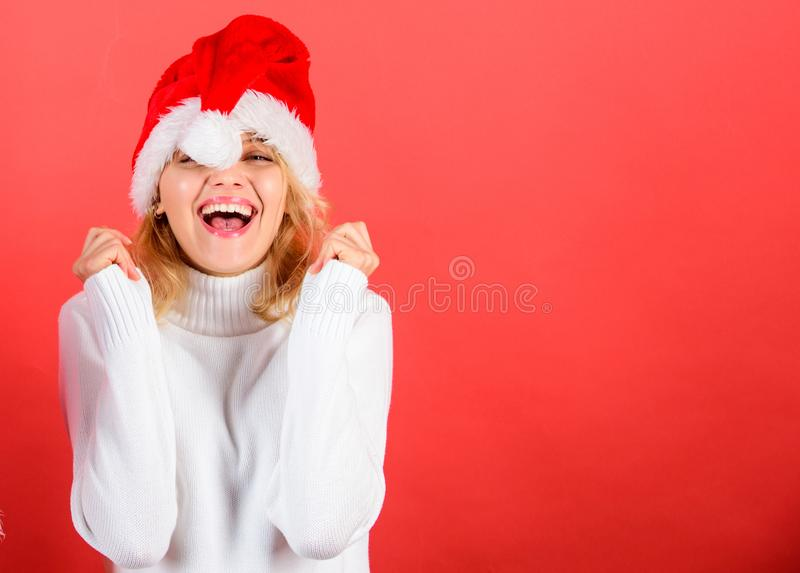 Christmas masquerade or karnival concept. Girl cheerful face celebrate christmas. Woman celebrate winter holiday. Christmas party. Woman in santa hat with stock photo