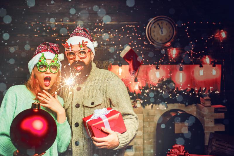 Christmas man hold bomb. Happy couple in Santa hat at Xmas family party. New year party in home. stock photography