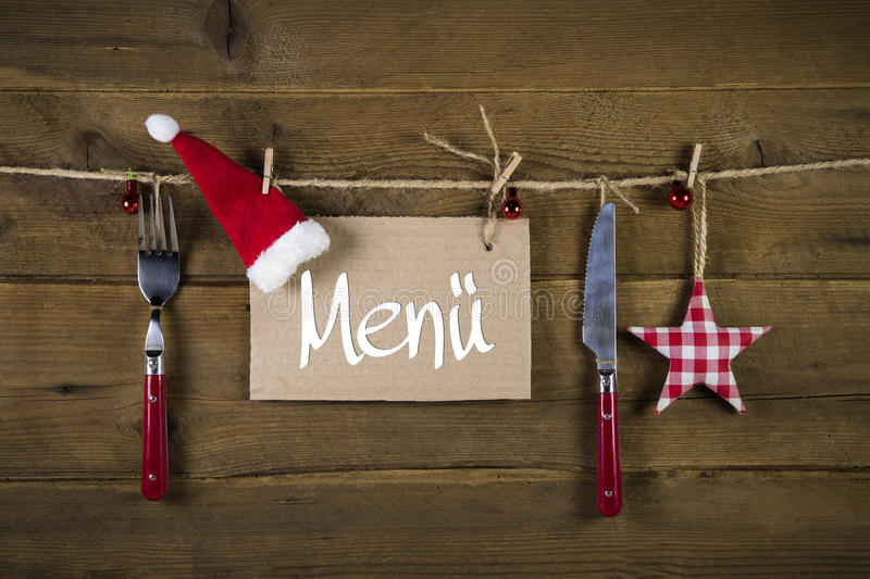 Christmas menu card for restaurants with knife and fork on wooden background. royalty free stock images