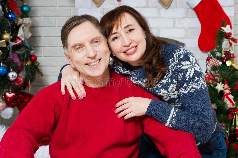Christmas middle aged couple portrait in front of christmas tree, loving family celebration new year, holiday people royalty free stock image