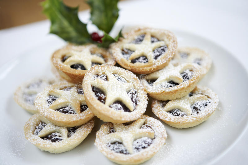 Christmas Mince Pies. Closeup of Christmas mince pies on plate royalty free stock image