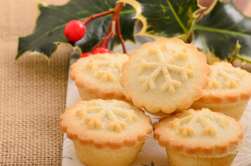 Christmas mince pies. Home made Christmas mince pies on a hessian background stock images
