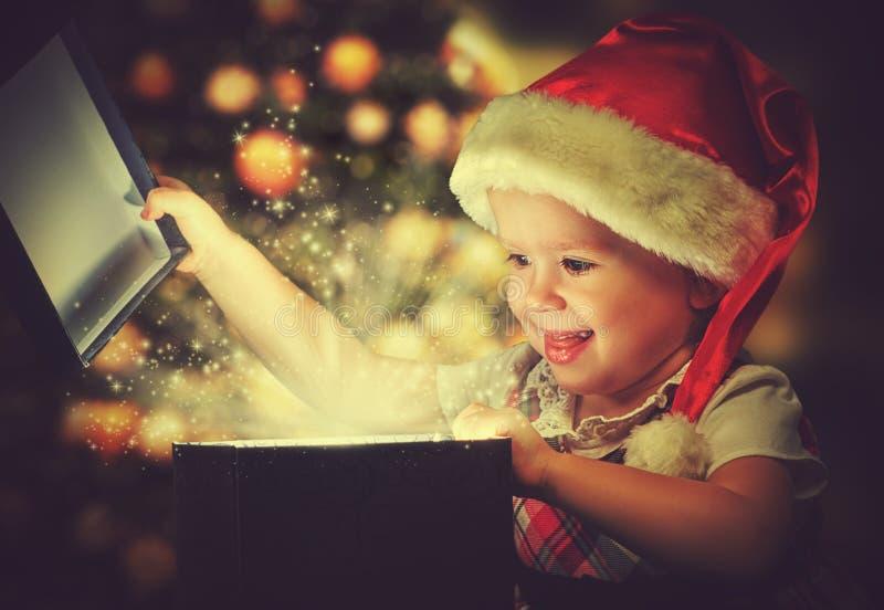 Christmas miracle, magic gift box and child baby girl. Christmas miracle, magic gift box and a child baby girl royalty free stock photo