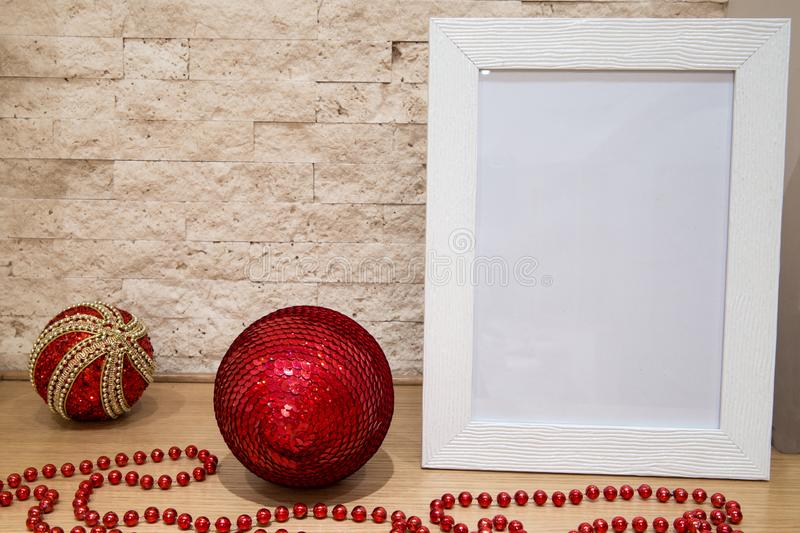 Christmas mock up, greeting card, red beads, red and golden christmas balls and brick wall background. Copy space. Christmas royalty free stock photos