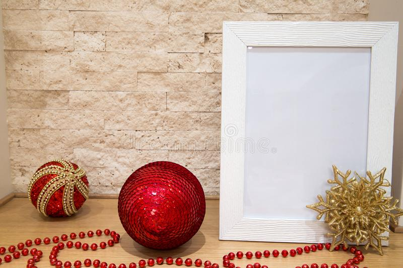 Christmas mock up, greeting card, red beads, golden snowflafe, r royalty free stock photography