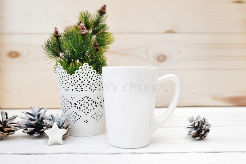 Christmas mock up styled stock product image white cup, Christmas scene with a white blank coffee mug that you can royalty free stock photography