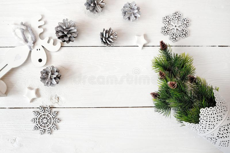 Christmas mockup on a white wooden background with snowflakes, a deer and a Christmas tree. Flat lay, top view stock images