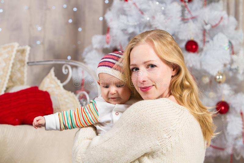 Christmas of mom and her baby stock photo