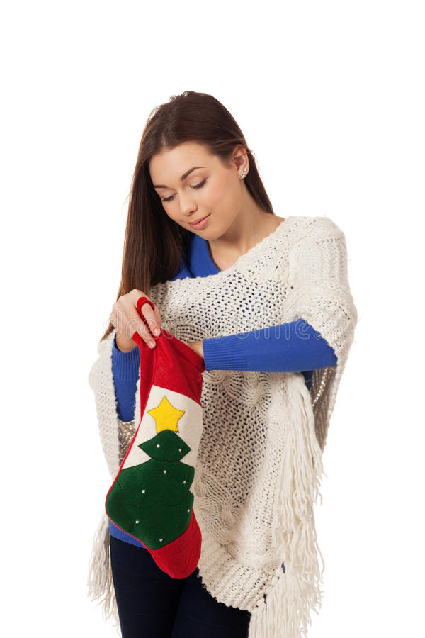 Christmas mood. Girl with Christmas stocking on isolated white royalty free stock photo