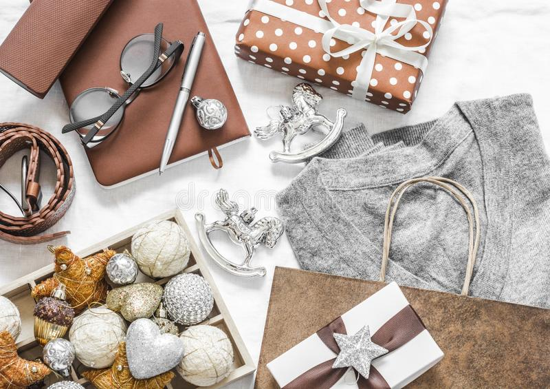 Christmas mood background. Holiday Christmas shopping sale concept. Grey cashmere pullover, gift box, notepad, christmas stock image